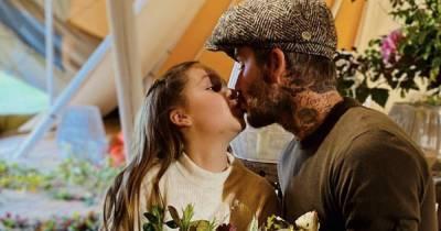 David Beckham divides fans after kissing daughter Harper, 9, on the lips while fruit foraging
