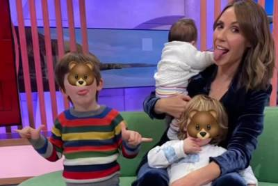 The One Show's Alex Jones is surrounded by her three kids as she returns to work two months after giving birth