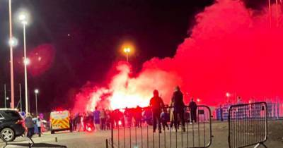 Shocking images show rowdy St Johnstone fans flout lockdown rules and throw flares at McDiarmid Park