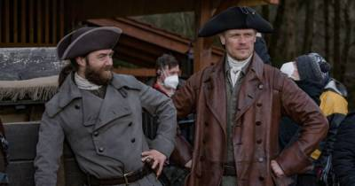 Outlander shares behind the scenes snap of Jamie Fraser and Roger Mac and fans can't wait for season 6