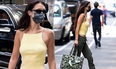 Bella Hadid shows off her toned abs in low-rise green cargo pants as she heads to a photo shoot